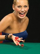 Happy woman throwing dice