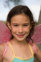 Portrait of young girl wearing fairy wings