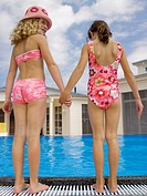 Girls holding hands near pool