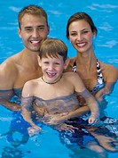 Happy family in pool