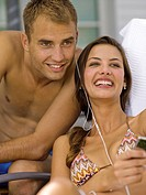 Couple listening to music player (thumbnail)