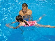 Man teaching girl how to swim (thumbnail)