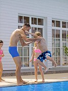 Father throwing son in pool (thumbnail)