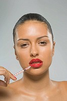 Portrait of a young woman getting a Botox injection on her lips