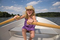 Young girl rowing boat