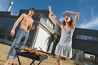 Happy couple at barbecue
