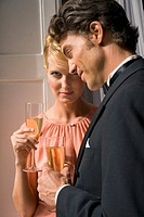 Close-up of a young couple holding champagne flutes