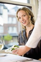 Woman being served at restaurant