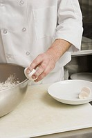 Chef cracking egg on bowl (thumbnail)