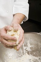 Chef molding dough in hands