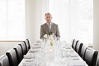Senior businessman sitting at head of table
