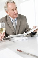 Senior businessman reading menu