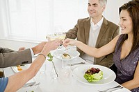 Couples toasting at restaurant