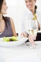 Waitress serving wine at restaurant