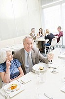 Senior couple sitting at restaurant
