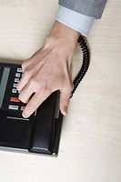 BusinessmanÆs hand on telephone receiver