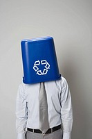 Businessman with recycling bin over head