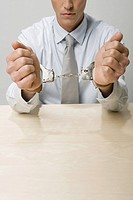 Close up of businessman in handcuffs