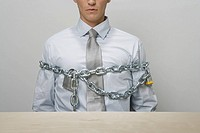 Businessman chained and locked