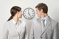 Business people looking at clock