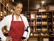 Saleswoman in wine store