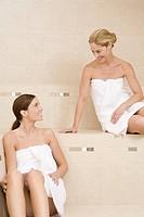 Two women sitting in sauna