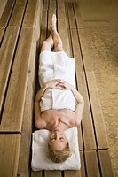 Woman laying in sauna
