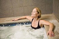 Woman sitting in hot tub