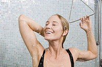Woman in bathing suit taking shower
