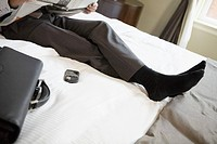 Businessman laying on bed