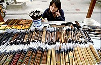 A beautiful Chinese woman sells Calligraphy brushes in Xian, China