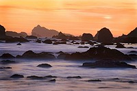 Sunset and misty waves breaking on beach in Crescent City, California. USA