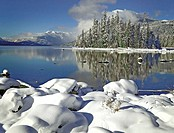 Snow on rocks on the shore of Lake Wenatchee, Lake Wenatchee State Park, Washington State, USA