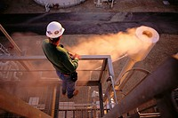 Worker at natural gas fired cogeneration power plant