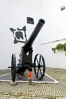 The protection Cannon in the Carolinenthor Castle built in 1580 and child, Brasov, Romania