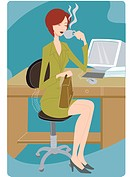 Businesswoman taking a coffee break at her desk (thumbnail)