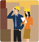 Man and woman wearing hardhats inspecting a building site