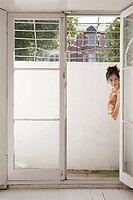 Woman peering around door (thumbnail)