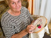 Senior woman doing crochet (thumbnail)