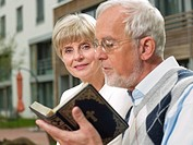 Senior couple with a bible
