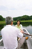 Older Couple In A Boat on a Lake