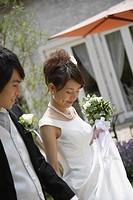 Bride and Groom Walking in Garden