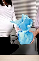 Pregnant office worker receiving a present (thumbnail)