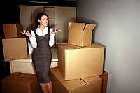 Businesswoman among boxes