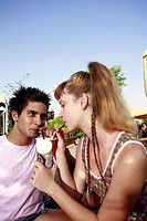 Teenage couple sharing a soda