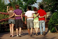 Teenagers taking a walk in amusement park