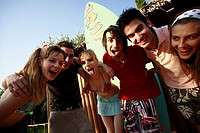 Teenagers posing in amusement park