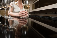 Woman drinking wine in a bar