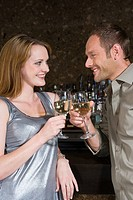 Couple toasting in a bar