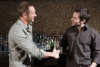 Male friends drinking in a bar